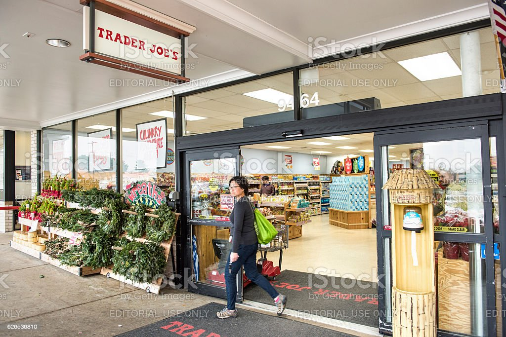 Trader Joes grocery store entrance with sign, display and view on...