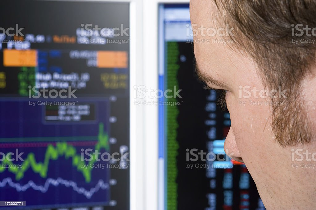 Trader watching trading screen stock photo
