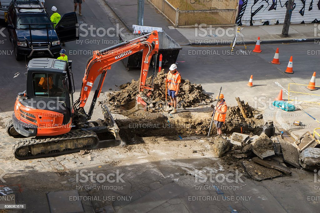 Tradesmen digging a hole in Melbourne stock photo