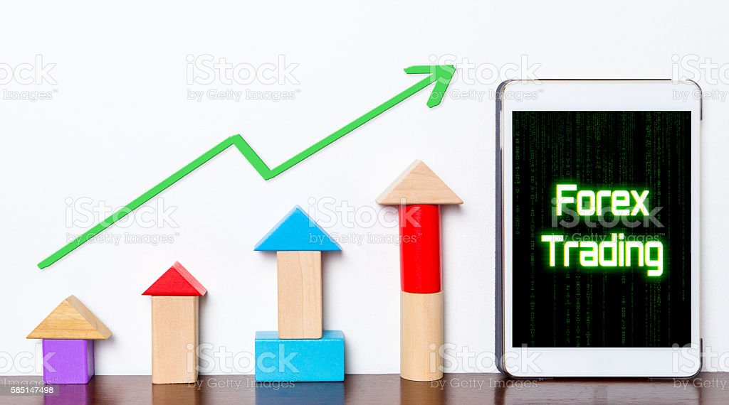 Trading successfully on Forex stock market on tablet. stock photo