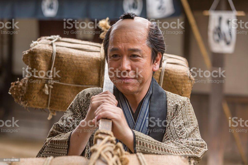 Tradional Japanese Farmer Taking Produce to Market stock photo