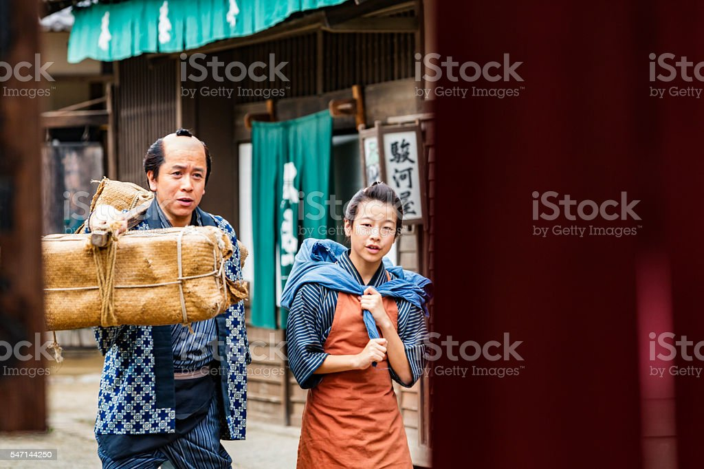 Tradional Japanese Father and Son Farmers Taking Produce to Market stock photo