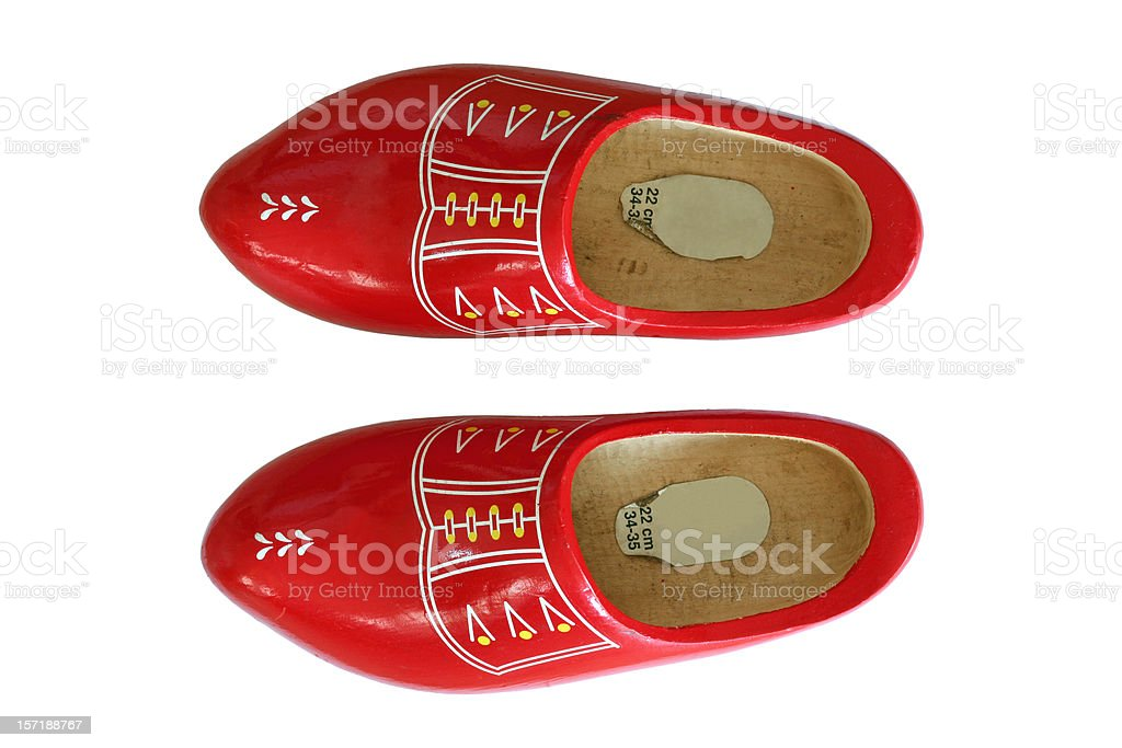 Tradional red Dutch wooden shoes, topview isolated on white stock photo