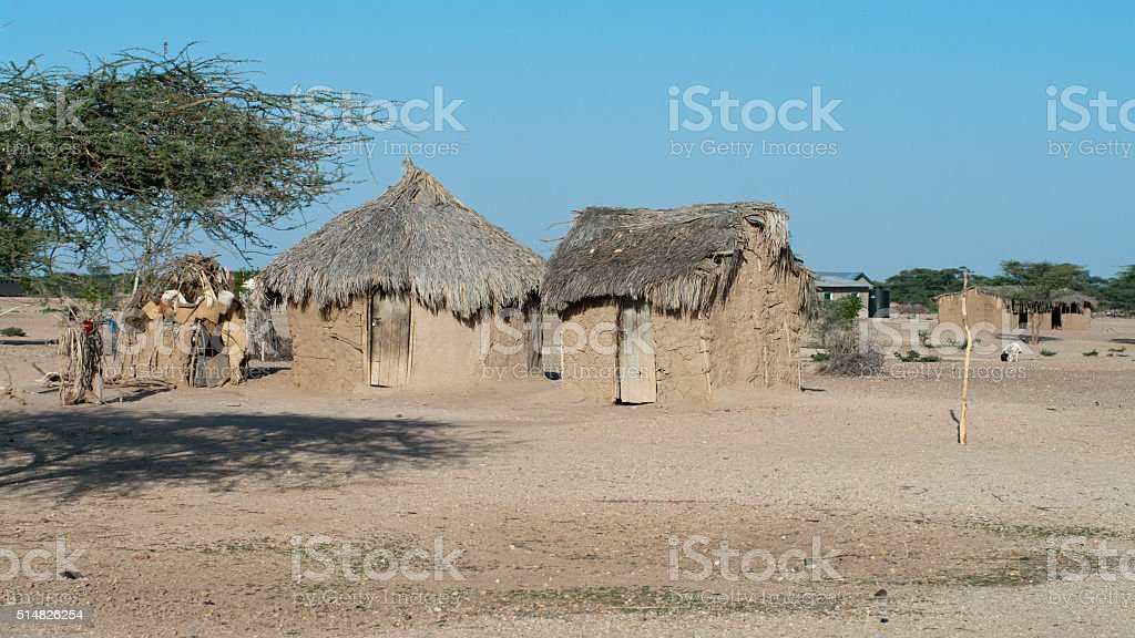 Traditional african huts in Kenya stock photo
