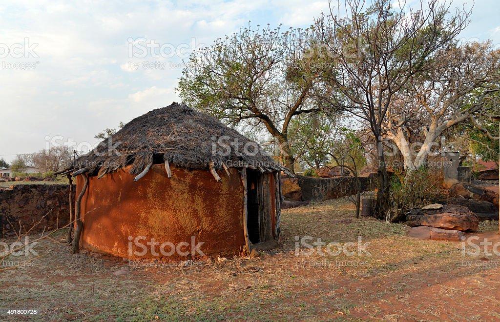 Traditional African mud hut. Botswana. stock photo