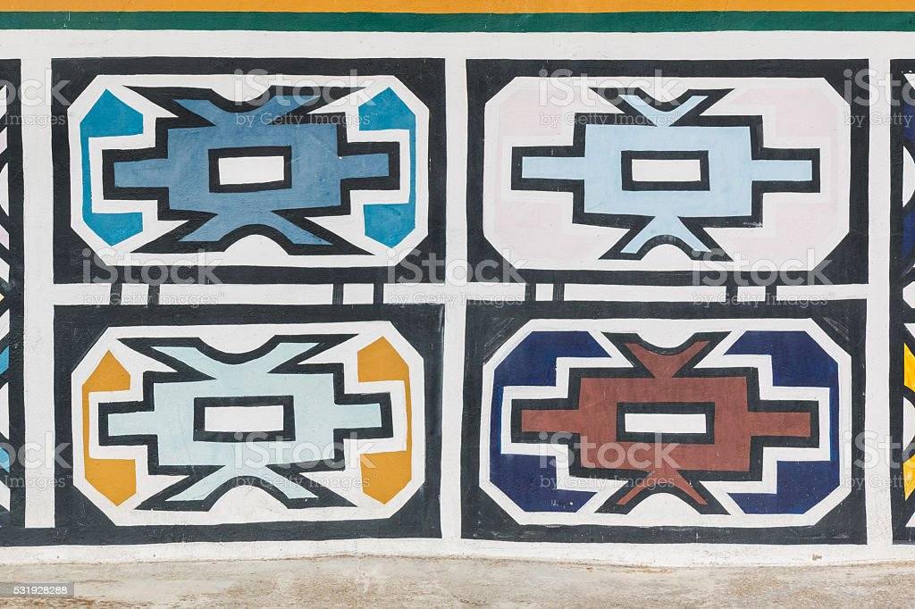 Traditional african Ndebele patterns on the wall. stock photo