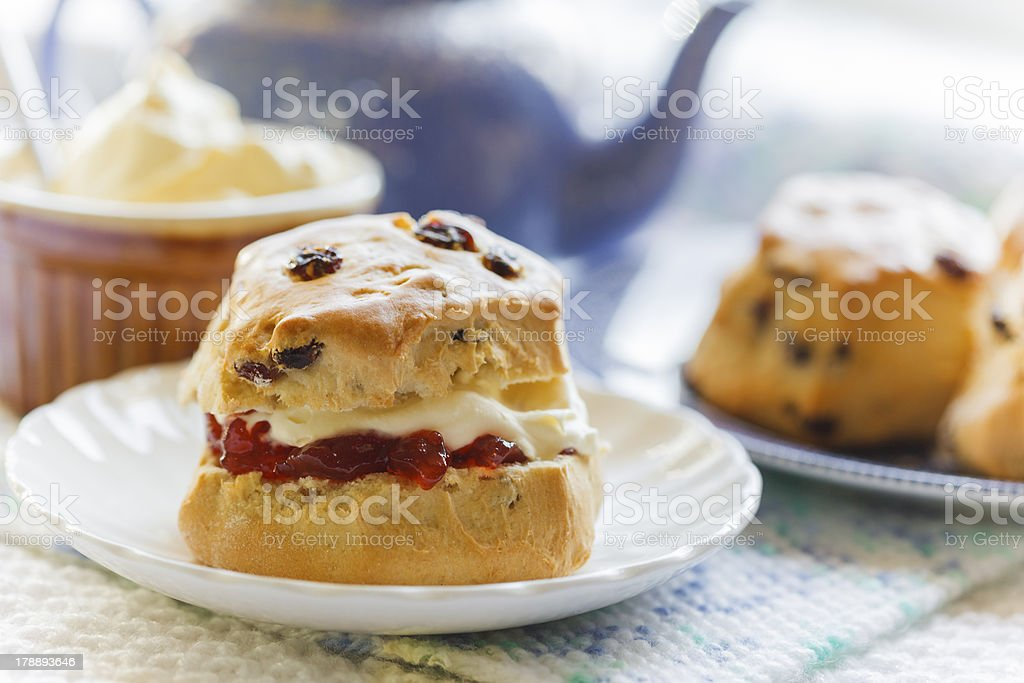 Traditional afternoon tea with scones, jam and cream stock photo