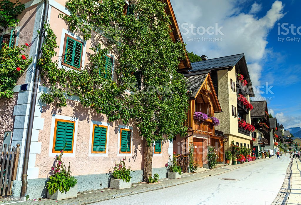 Traditional alpine village street with colorful flowers,Austria,Europe stock photo