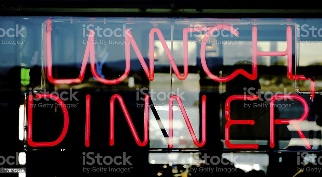 Traditional american diner neon sign. Restaurant offers Lunch and Dinner. stock photo