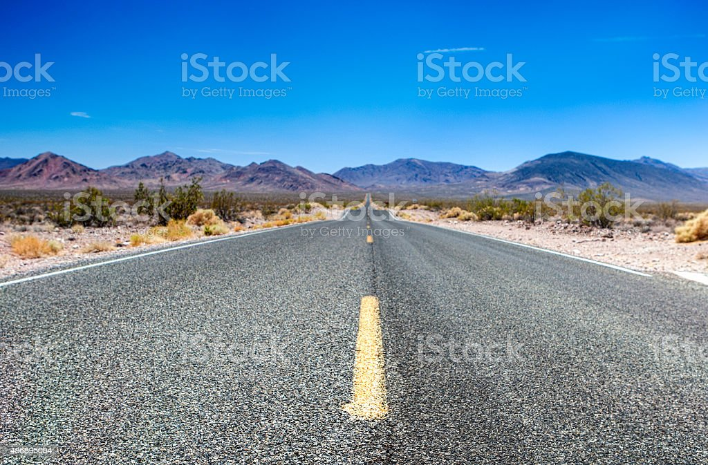 Traditional American Highway Among High Mountains to Death Valley Area stock photo