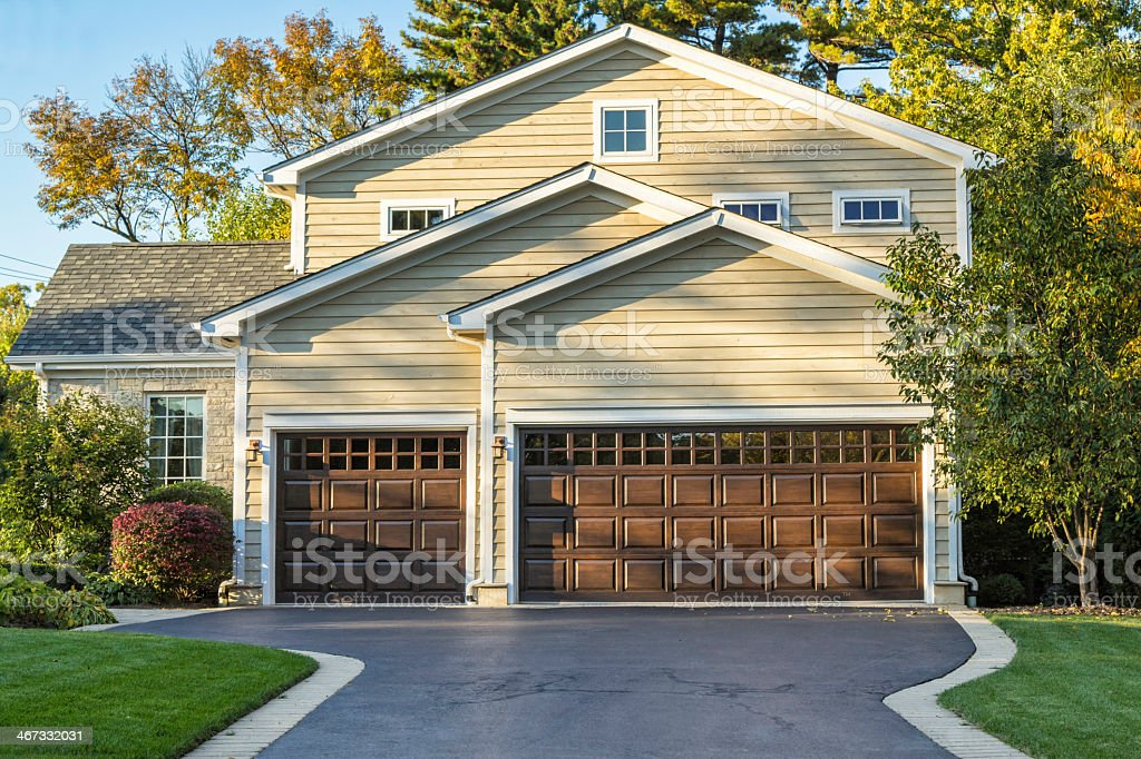 Traditional American home with garage and front garden stock photo