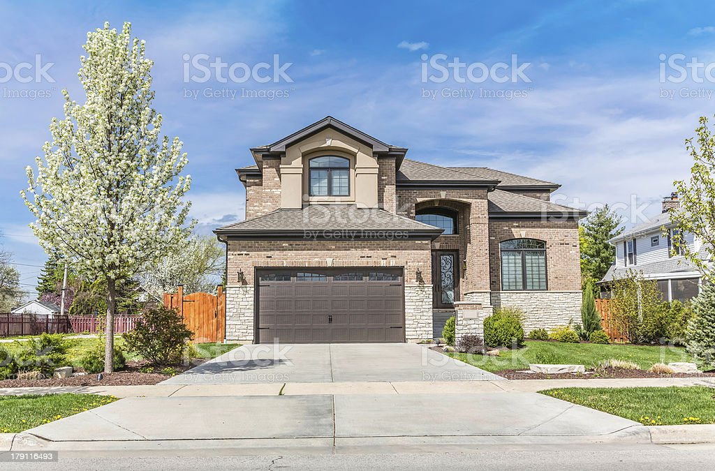 Traditional American Home with Garage stock photo