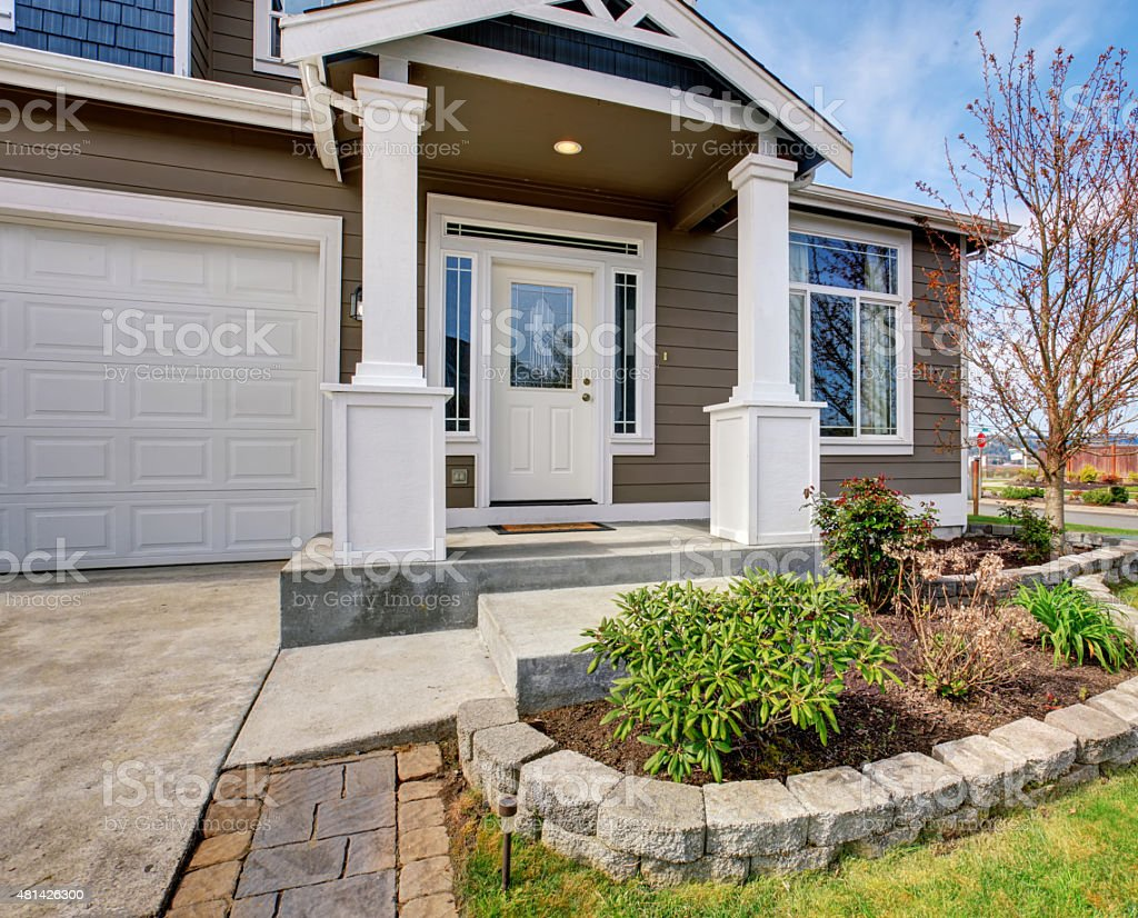 Traditional american home with nice lawn. stock photo