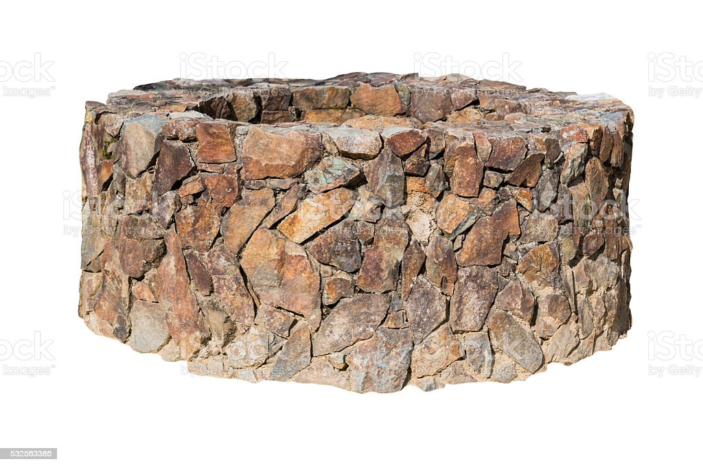 Traditional Ancient stone well on white. stock photo