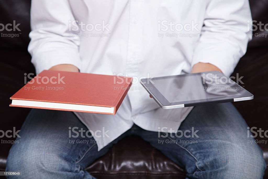 Traditional and Electronic Book stock photo