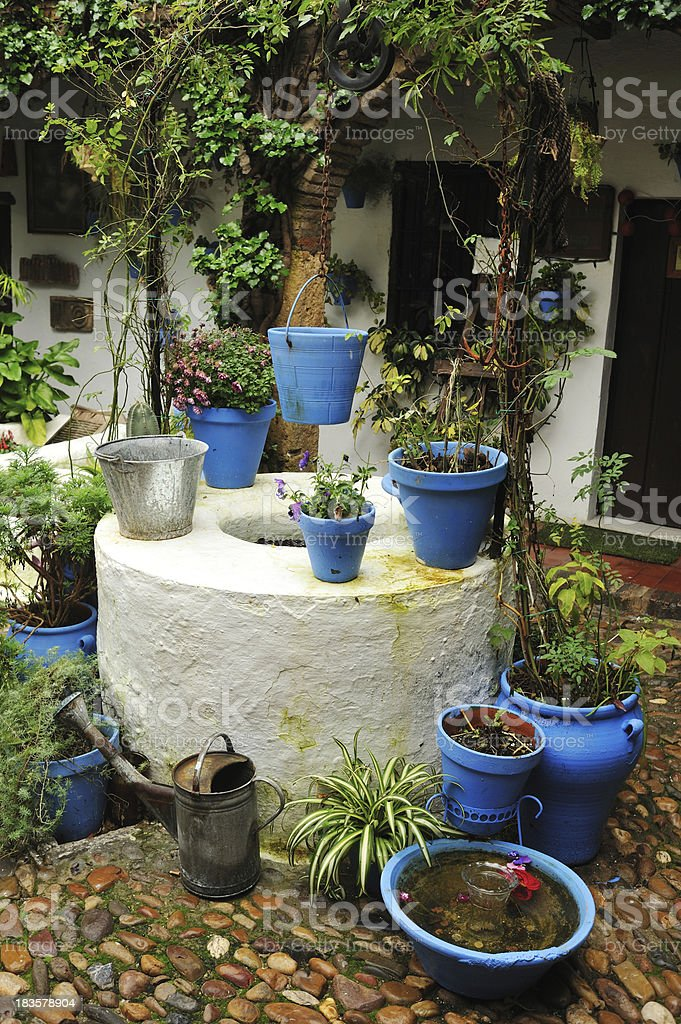 Traditional Andalusian home with patio and potted plants royalty-free stock photo