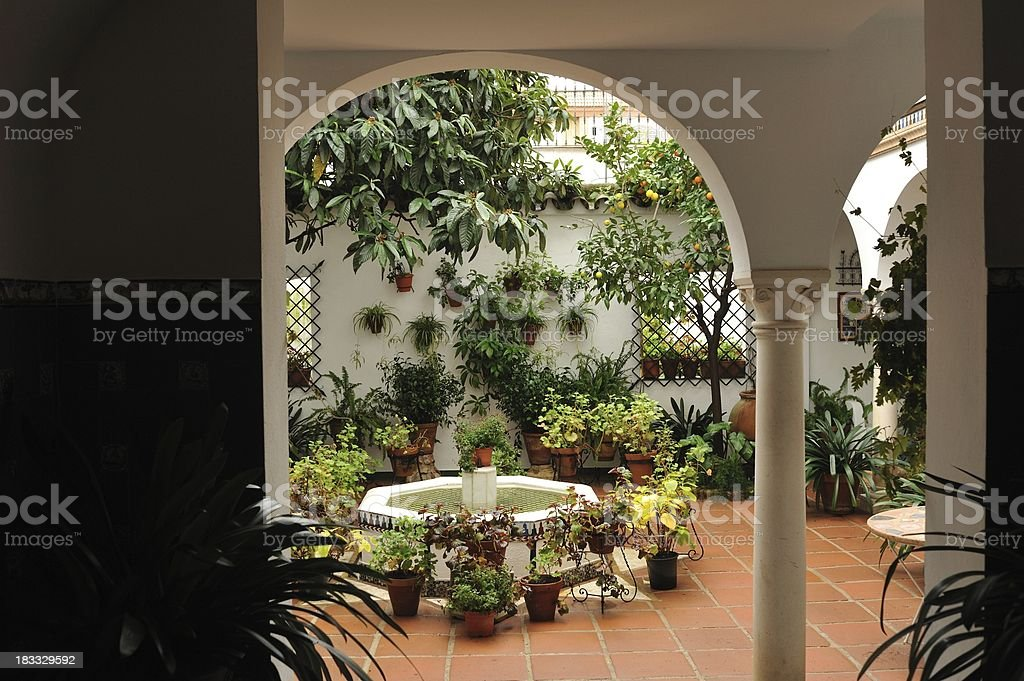 Traditional Andalusian house with patio and fountain royalty-free stock photo