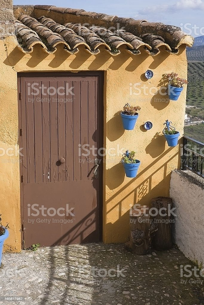Traditional Andalusian townhouse decorated with flower pots royalty-free stock photo