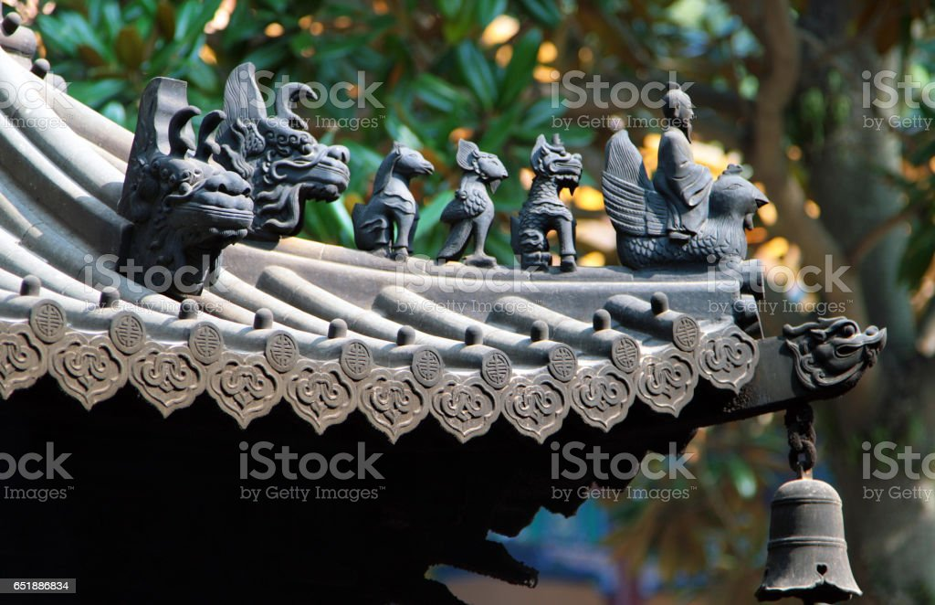 Traditional animal figures on the roof of chinese temple stock photo