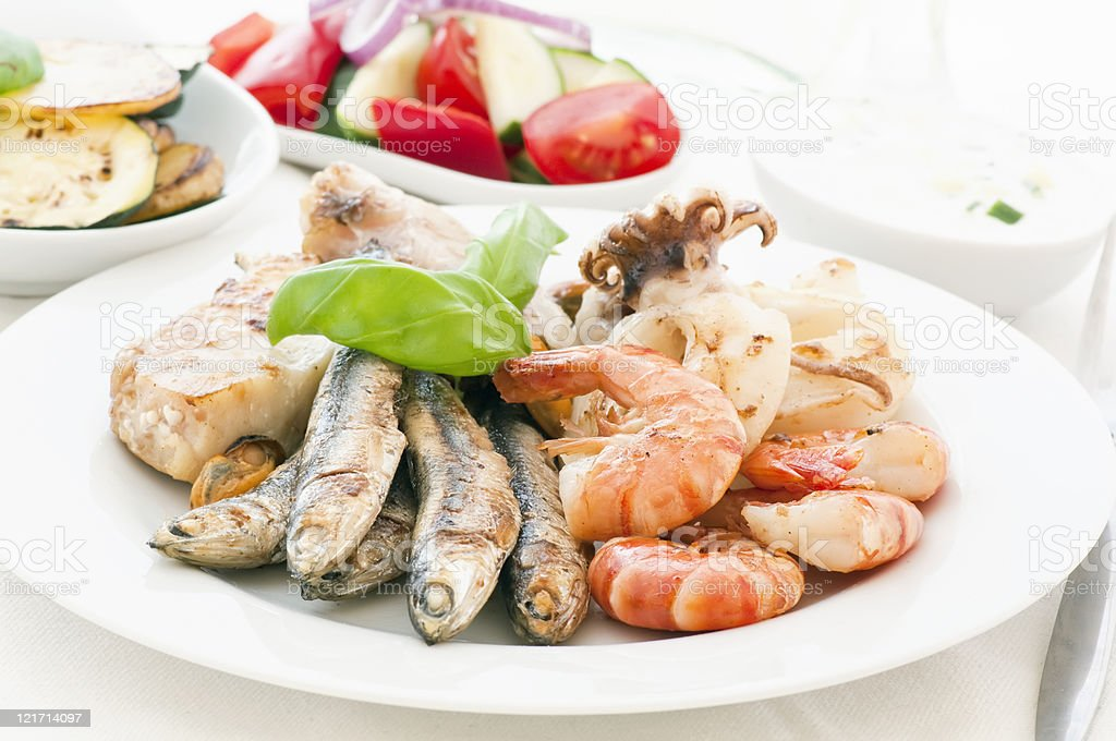 Traditional antipasto with focus on plate of seafood stock photo