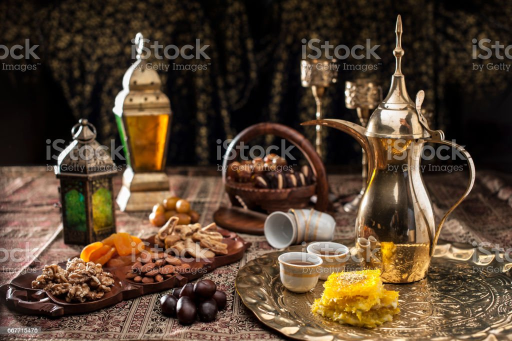 Traditional Arabian coffee, nuts and sweets stock photo