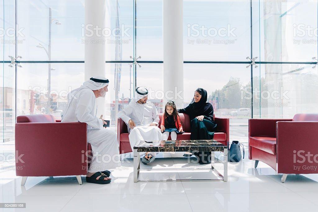 Traditional  Arabic family enjoying at lounge stock photo