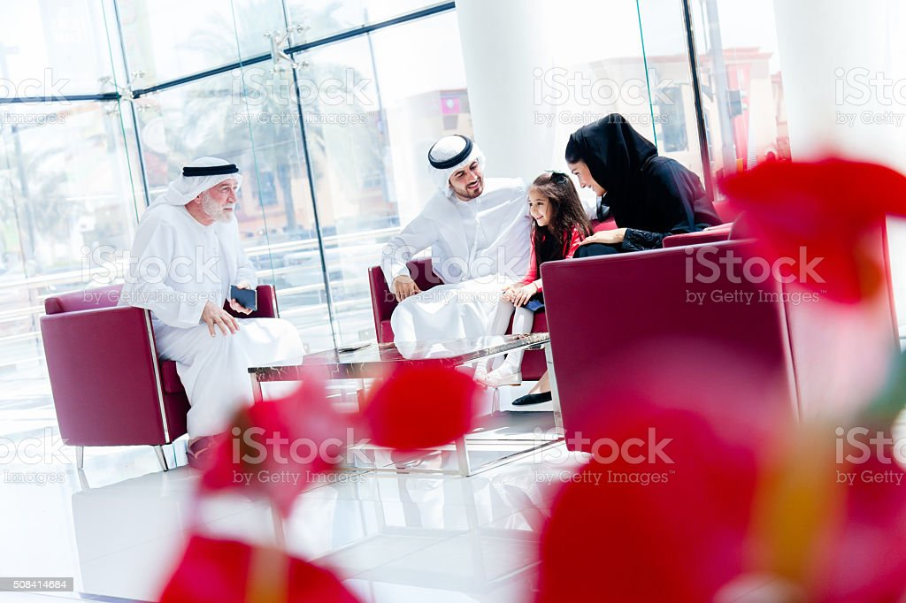 Traditional  Arabic family enjoying at lounge stock photo