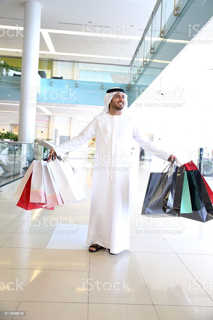 Traditional Arabic family in  Shopping Mall stock photo
