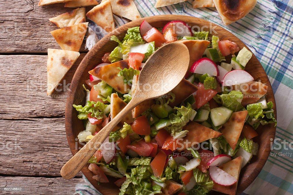 Traditional Arabic fattoush salad closeup. Horizontal top view stock photo
