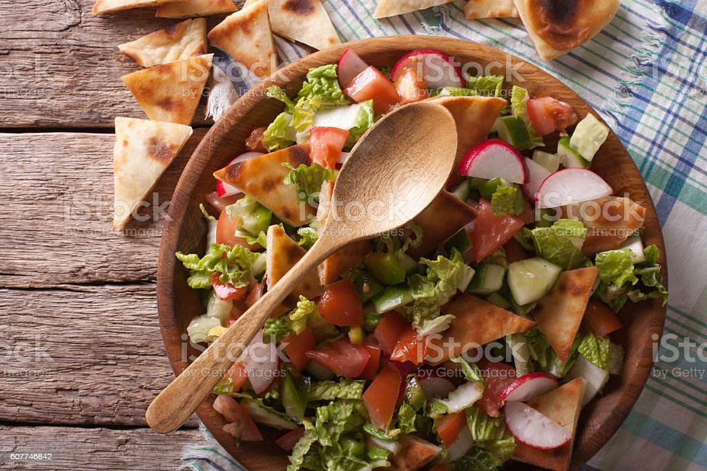 Traditional Arabic fattoush salad closeup. Horizontal top view stock photo