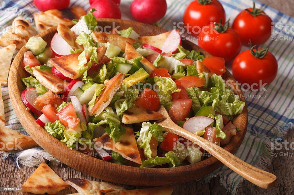 Traditional Arabic fattoush salad close-up on a plate. horizontal stock photo