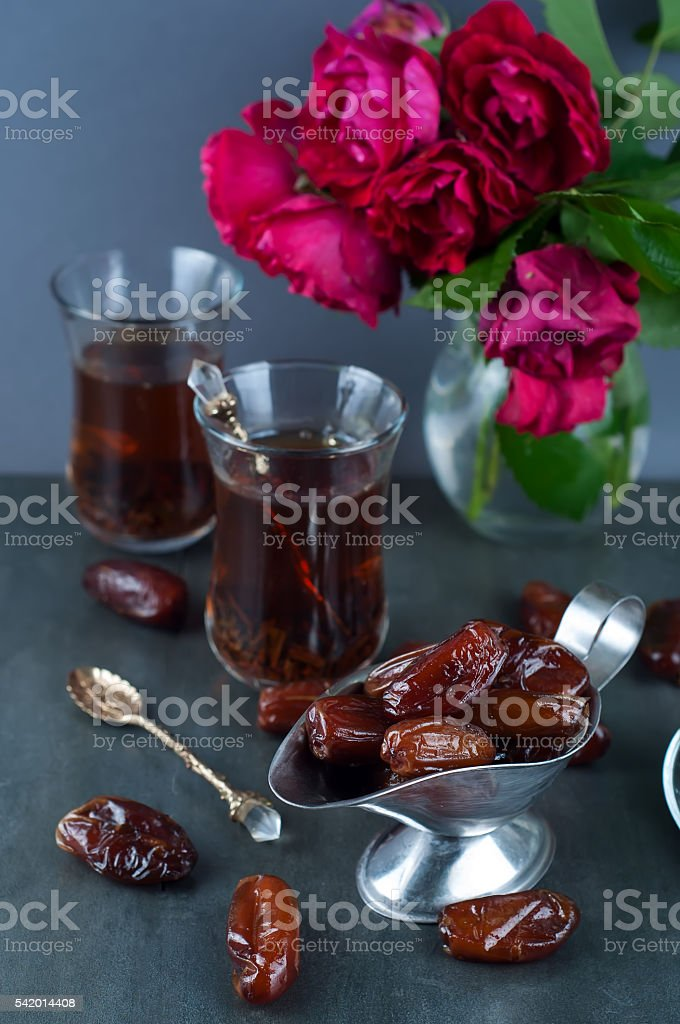 Traditional arabic tea and dry dates. stock photo