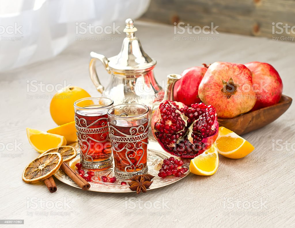 Traditional arabic tea with metal teapot and fruits stock photo