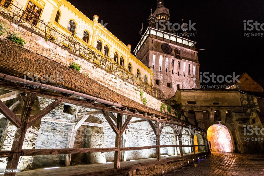 Traditional architecture and clock tower at night in Sighisoara old town, Transylvania, Romania stock photo