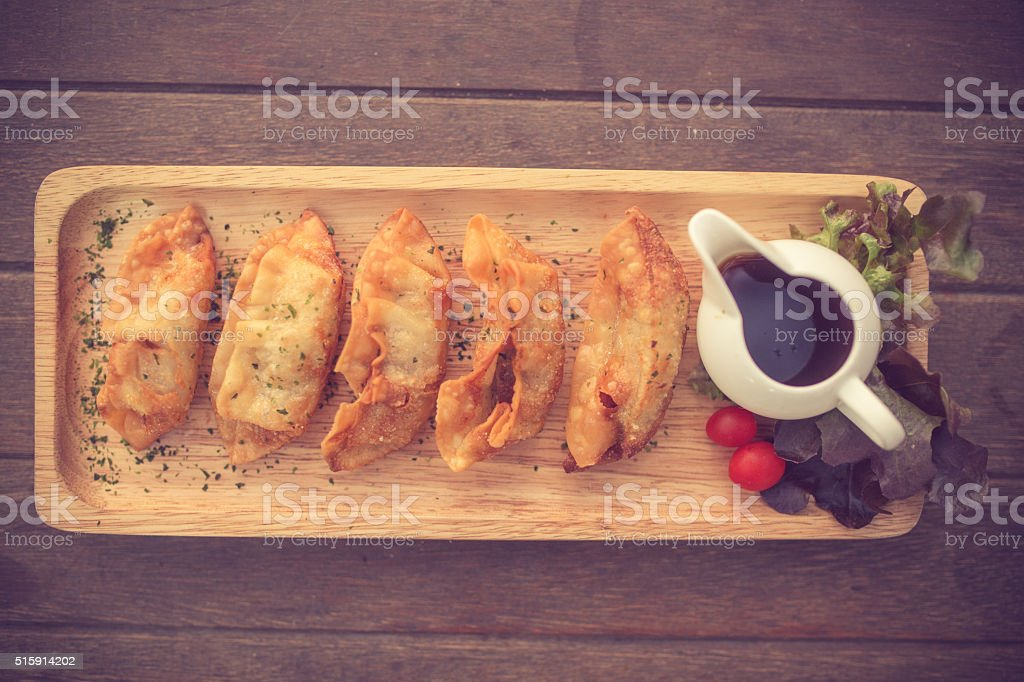Traditional asian pan fried gyoza dumplings with a dip sauce.Vin stock photo