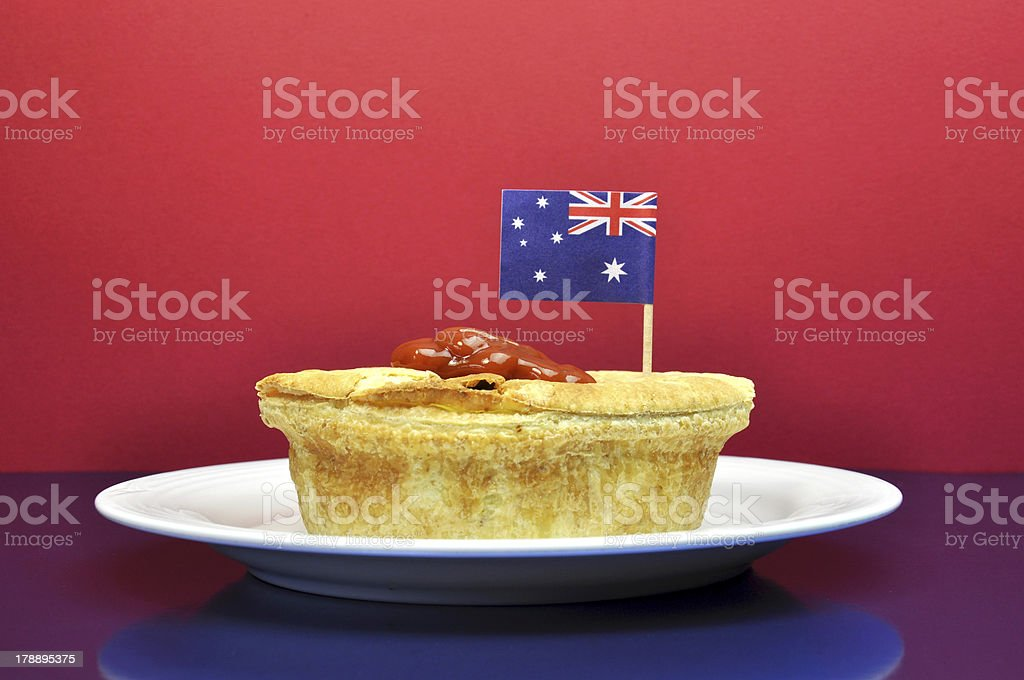 Traditional Australian Meat Pie and Sauce royalty-free stock photo