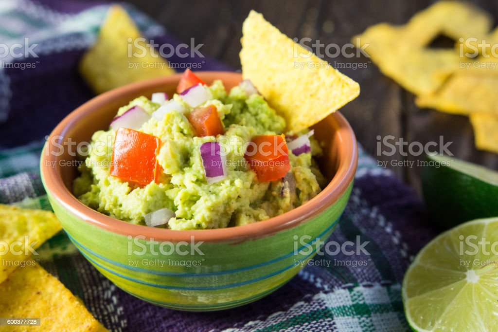 Traditional avocado guacamole with tortilla chips stock photo