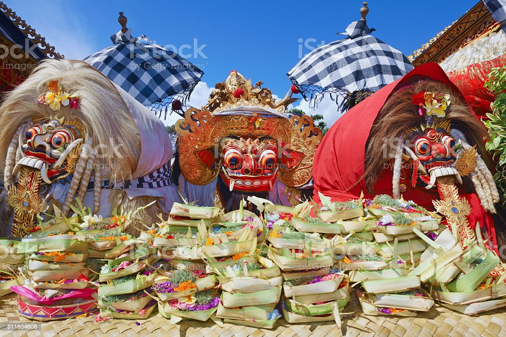 Traditional Balinese spirits - Barong and two witches Leyaks stock photo