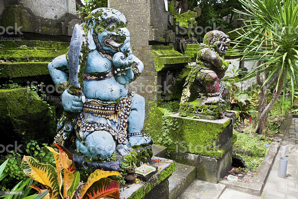 Traditional balinese warrior monster secure the temple royalty-free stock photo