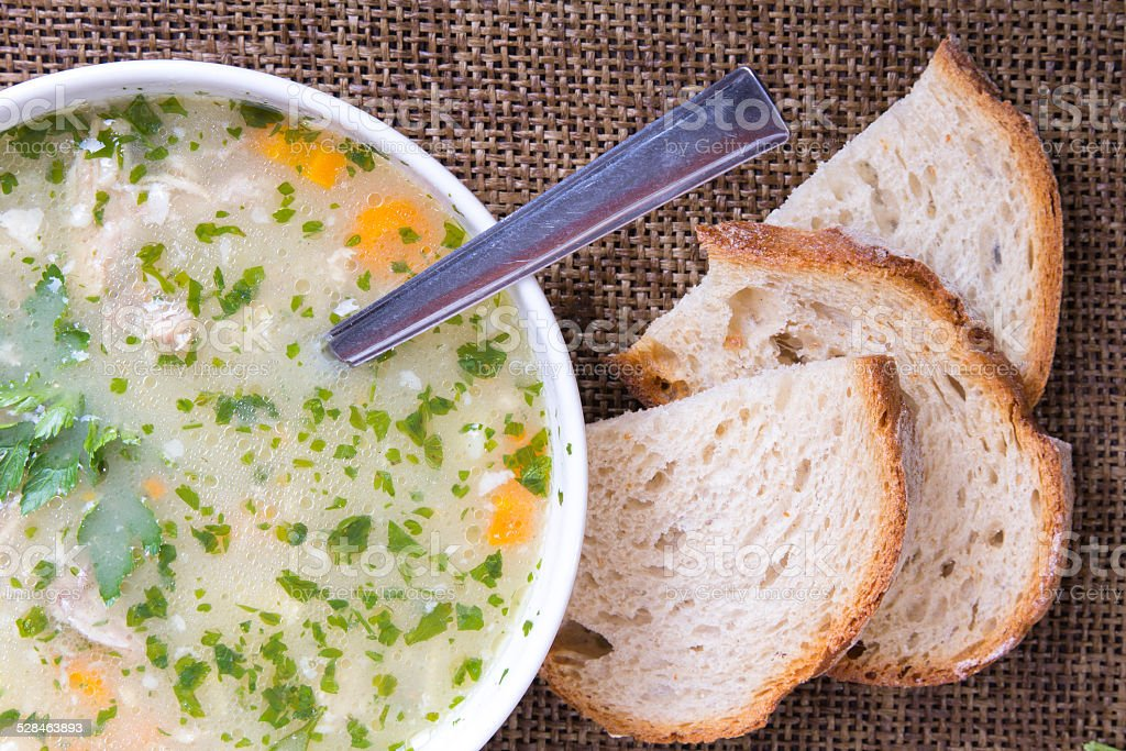 traditional barley soup in a white bowl with bread stock photo