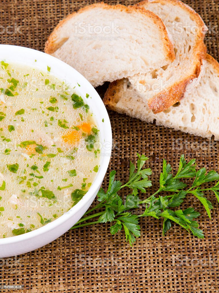 traditional barley soup with meat in a white bowl stock photo