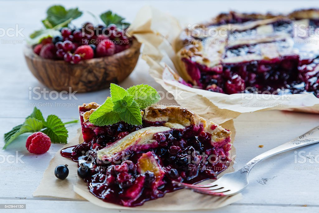 Traditional berry pie on rustic background stock photo