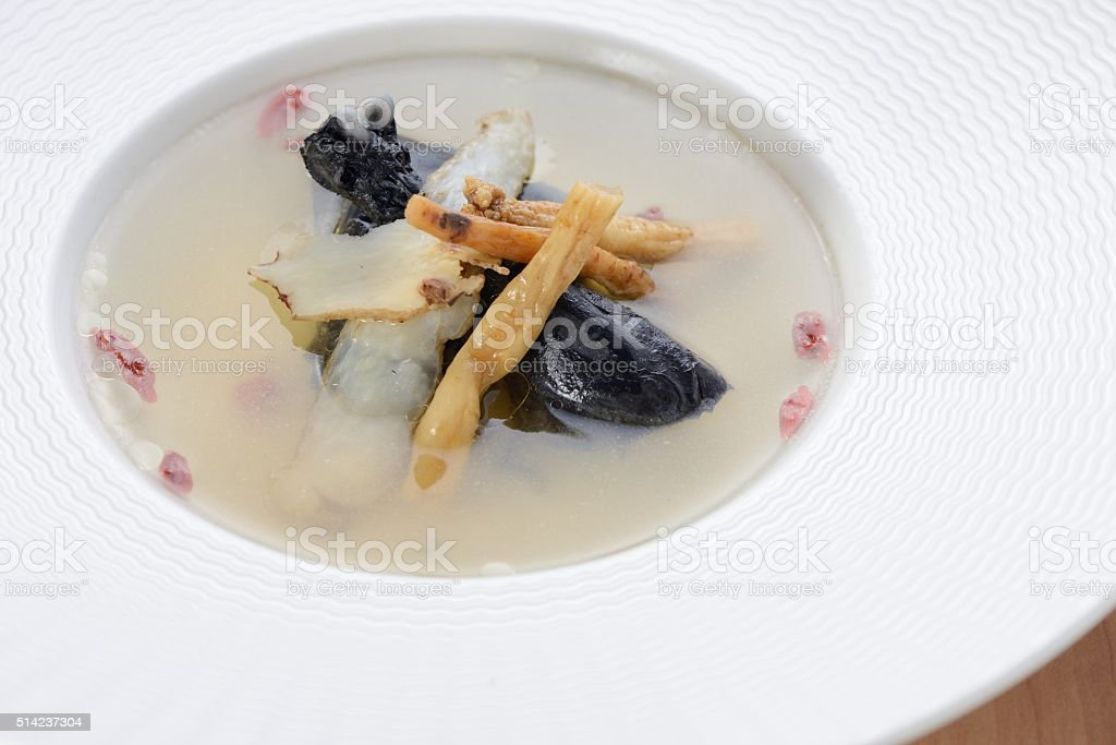 Traditional black chicken soup stock photo