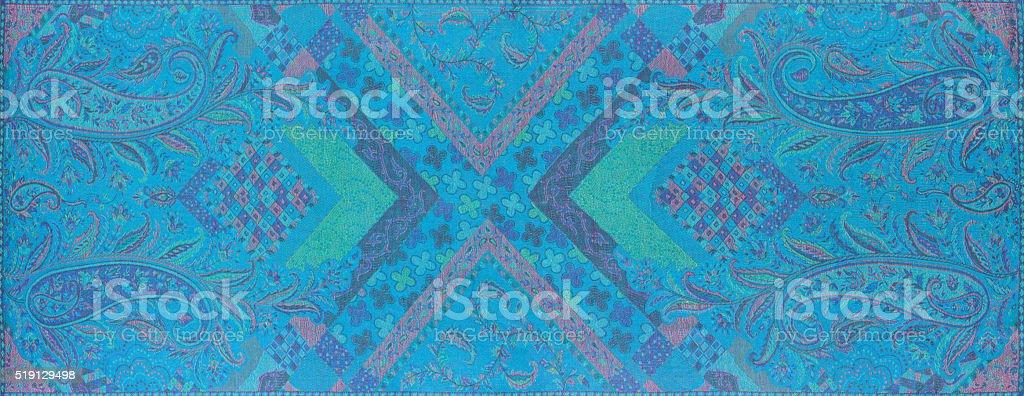Traditional blue paisley pattern silk headscarf sample stock photo