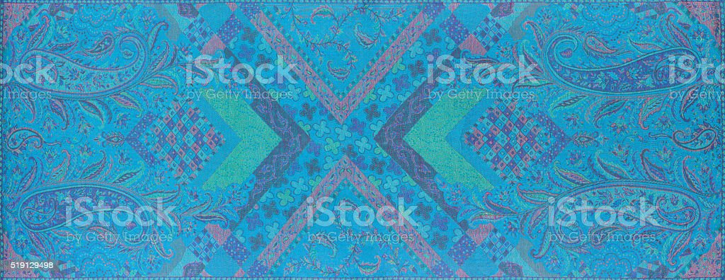 Traditional blue paisley pattern silk headscarf sample stock photo