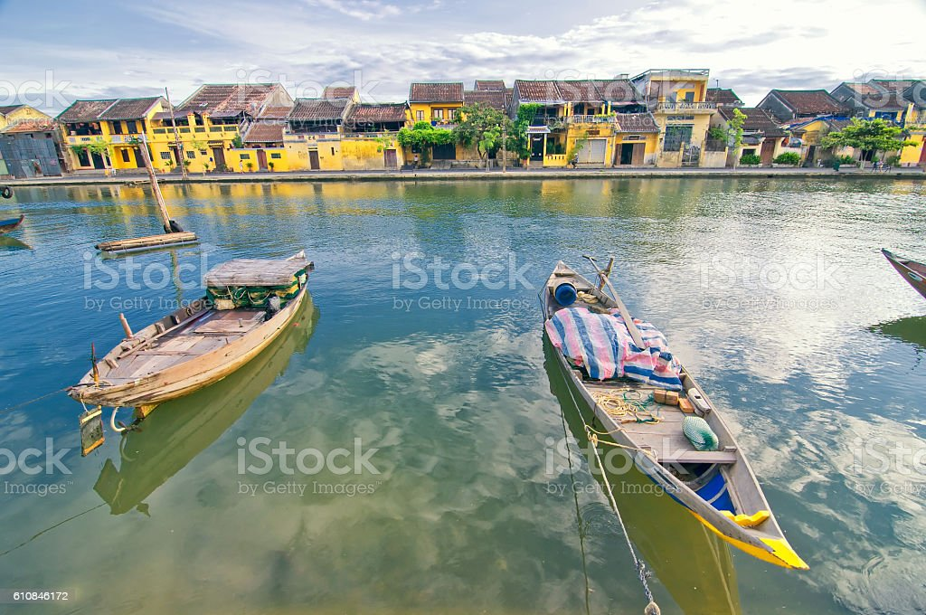 Traditional boats in Hoi An ancient town, Vietnam. stock photo
