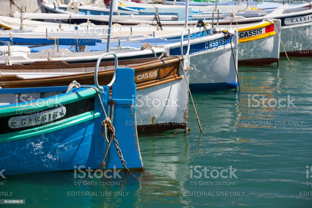 Traditional boats inside the harbor of Cassis stock photo