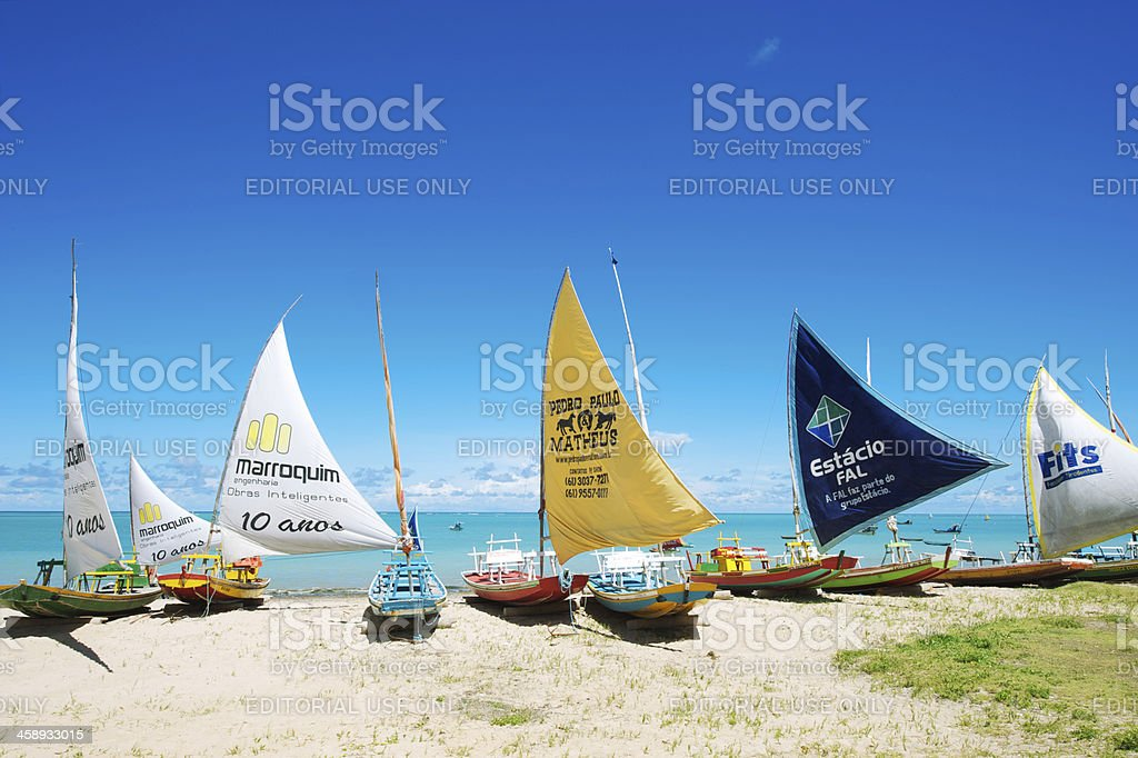 Traditional Brazilian Jangada Sailboats on Beach stock photo