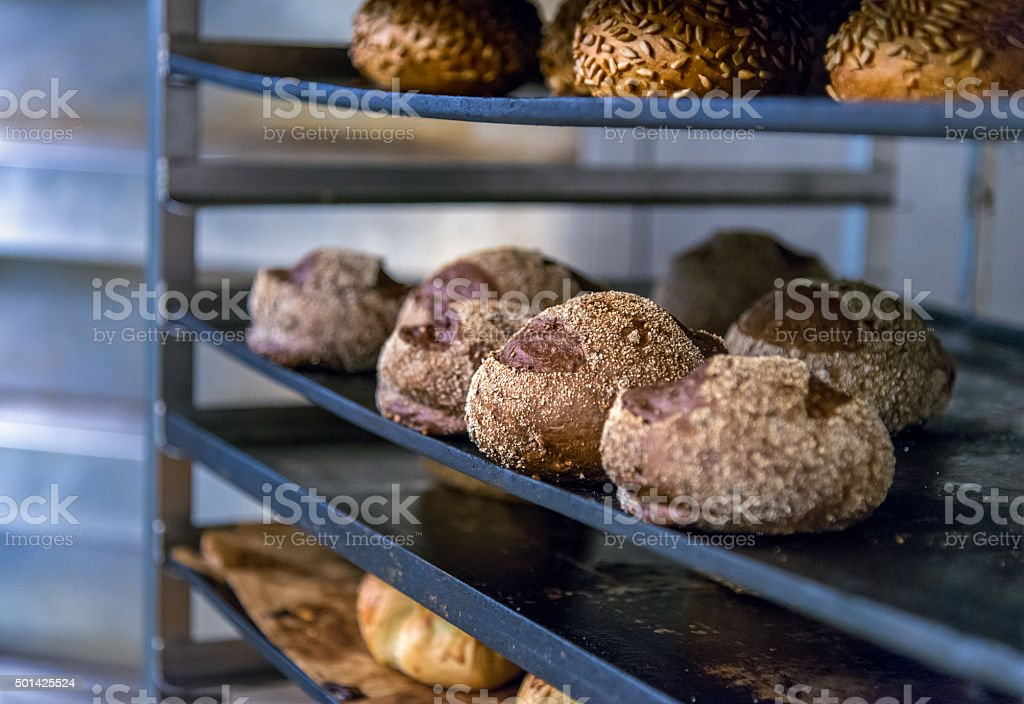 Traditional bread on colling rack in bakery stock photo