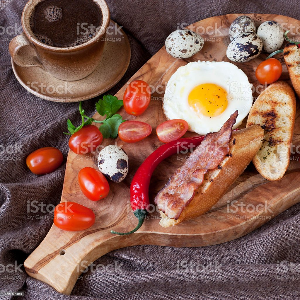 Traditional breakfast eggs with coffee cup stock photo